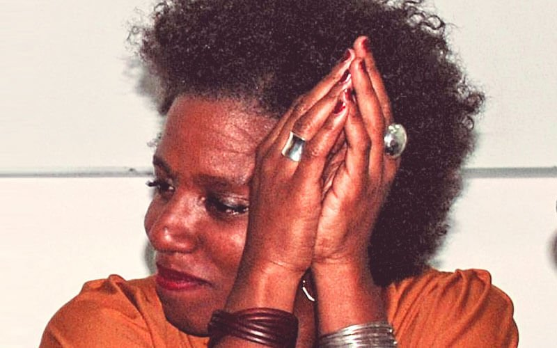 black woman with hands together